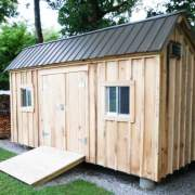 8x16 Saltbox style storage shed with a matte black metal roof.
