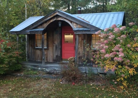 12x20 Weathered Gibraltar Cabin with painted red door