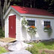 8x12 Gable shed with red roof, clapboard pine siding, red door and flower boxes.