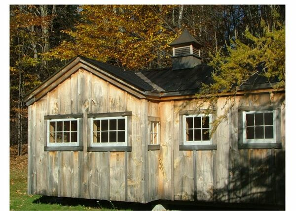 10x20 Heritage post and beam shed with lots of hinged windows and a black metal roof