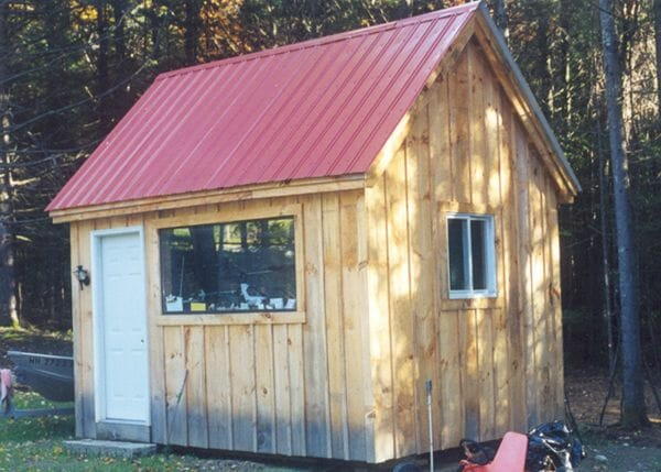 Hobby House with autumn red roof and custom millwork