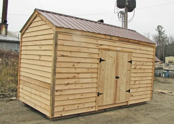 10x14 New Yorker Option A shed with clapboard siding and a brown metal roof