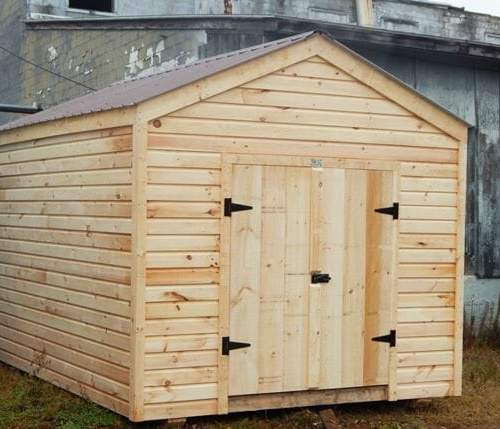 This 10x14 New Yorker storage shed was modified with siding and roof upgrades