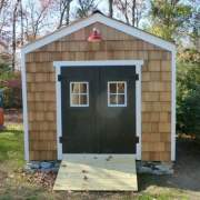 10x14 New Yorker Option B storage shed with siding and door upgrades