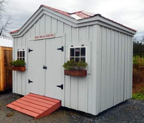 An upgraded tool shed with autumn red roof, flower boxes and paint