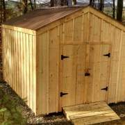 Upgrades shown on this New Yorker shed are pine battens and a tudor brown metal roof
