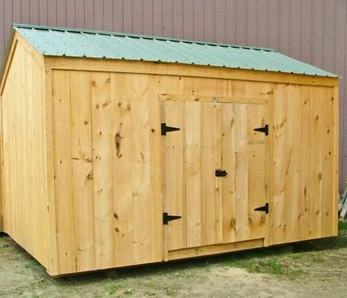 10x14 New Yorker Option A shed includes a set of wide pine double doors with a pressure treated ramp.