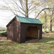 10x14 Standard Horse Run In Barn that has been painted brown