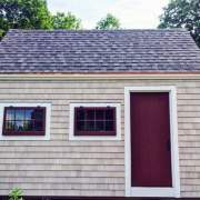 10x16 Harvester post and beam tiny house with asphalt shingle roof and cedar shingle siding