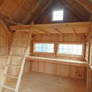 10x16 Hobby House inludes a loft, ladder, workbench and barn sash windows