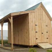 10x16 Hobby House with overhang, double doors and pressure treated ramp