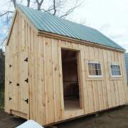 10x16 Hobby House - standard build with double doors, single door, windows, pine siding and green metal roof