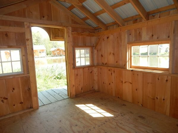10x14 Pond House post and beam cabin interior with extra windows