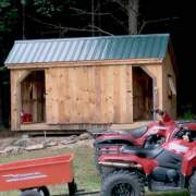 10x16 Three Sled Shed - Shown with sliding barn doors opened