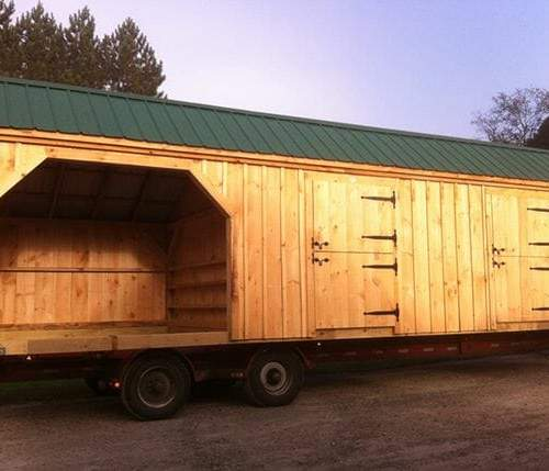 10x30 Stall Barn includes two dutch doors with two enclosed bays and a three sided run in area.