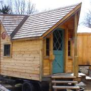 12x16 Backyard Retreat with Cedar Shingle Roof, Novelty Pine Siding, Antique Door and Extra Windows