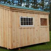 The Love Nest includes pine board and batten siding and a green metal roof
