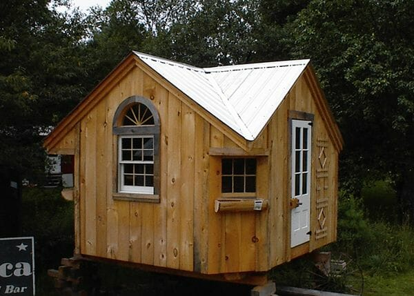 This prefab cottage was custom built with antique windows and doors.