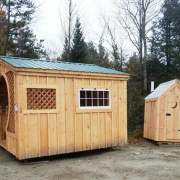 12x12 Love Nest next to a working outhouse
