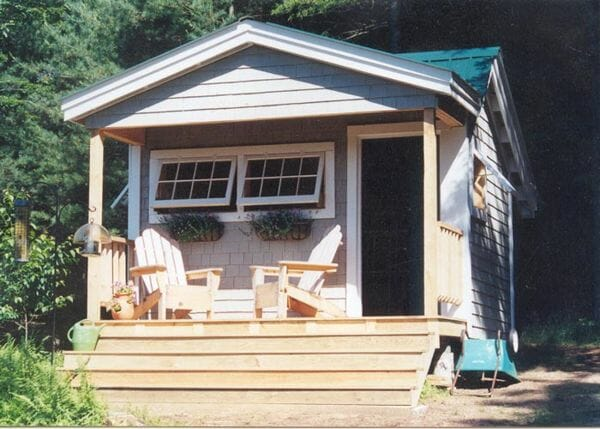 12x12 Potting Fort with cedar shingle siding, extra windows and custom staircase up to the porch
