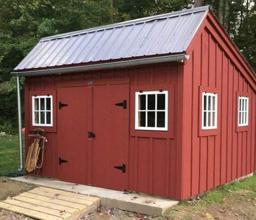 12x12 Saltbox bright red storage shed with extra windows and a charcoal gray roof