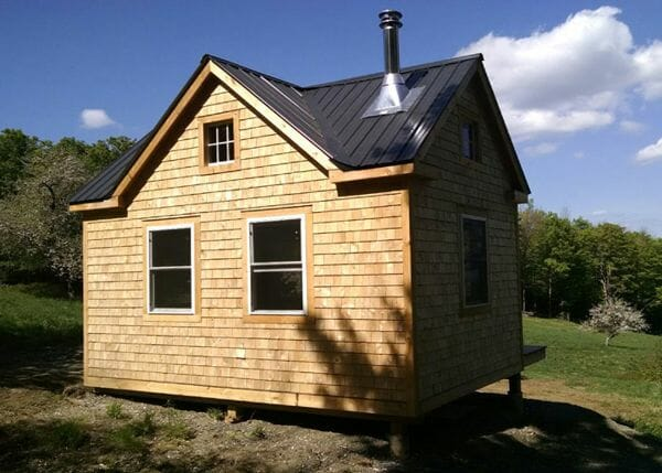 12x16 Cross Gable with matte black roof, cedar shingle siding, insulated windows and roof flashing for a wood stove.