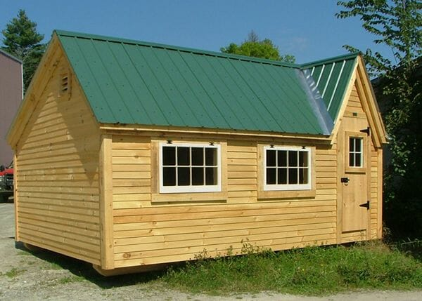 8x12 Dollhouse shed with clapboard siding and an Evergreen roof
