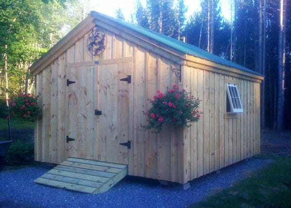 12x16 Gable - a storage shed kit that includes the floor system, double door with ramp, pine board and batten siding, two hinged windows and a corrugated metal roof.
