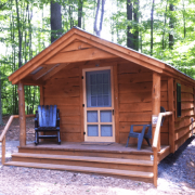 12x16 Home Office with live edge pine siding, skinned hemlock porch posts and insulated windows and door