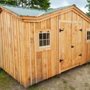 12x16 Cross Gable post and beam storage shed with dobule doors and two hinged barn sash windows
