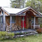 12x18 Gibraltar with skinned hemlock porch posts and insulated windows