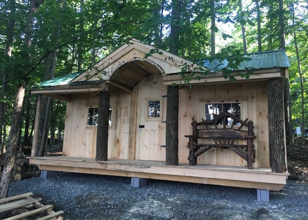 12x20 Gibraltar - with custom unskinned hemlock trunk porch posts