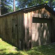 12x20 Garage built from complete pre-cut kit and stained a dark brown