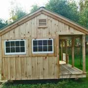 12x20 Gibraltar cottage includes board and batten pine siding, hinged windows, wood louvered vent and and a 4x20 porch.