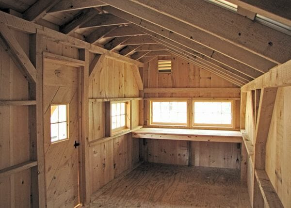 12x20 Gibraltar cabin interior includes a built-in workbench for woodworking or other hobbies.