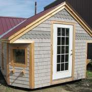 12x24 Cross Gable modified post and beam cabin with tudor brown roof, specialty siding and custom windows and doors
