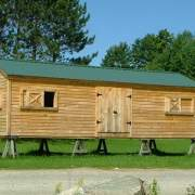 12x16 Gable barn customized with clapboard siding and sliding wooden window openings