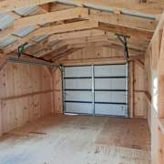 14x20 Barn Garage interior with overhead garage door and an addition of a hilnged window