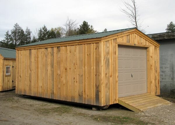 14x20 Barn Garage with evergreen metal roof, overhead door and pressure treated ramp.