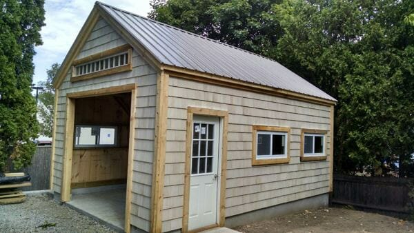14x20 One Bay Garage with cedar shingle siding, patrician bronze roof and insulated windows