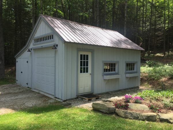 14x20 One Bay Garage with custom enclosed overhang, brown roof, and flower boxes