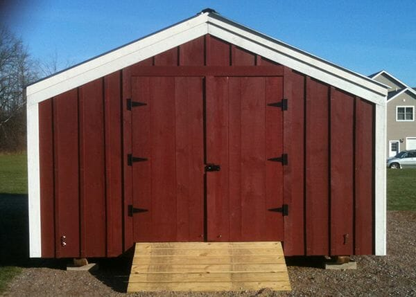 14x20 Barn that has been painted red with white trim