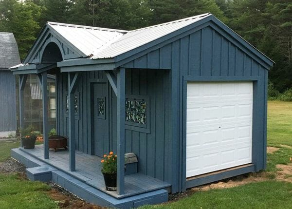 14x20 Gibraltar storage shed painted slate gray with a custom overhead garage door and silver galvanized roof upgrade