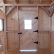 10x16 Harvester with single pine barn door with small fixed window