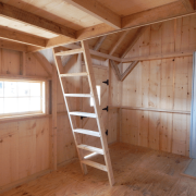 10x16 Harvester cabin interior with loft and ladder