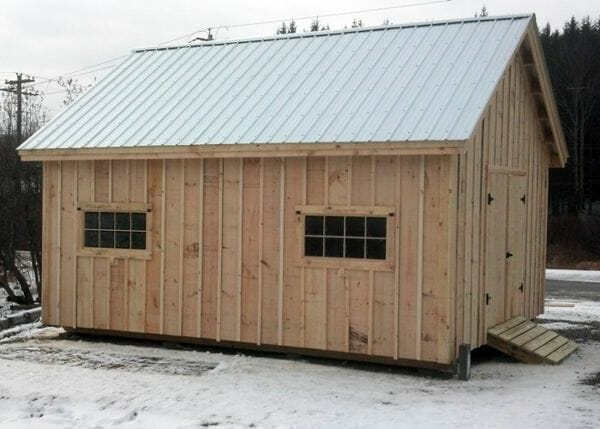 16x20 Barn with two windows and a silver roof upgrade.