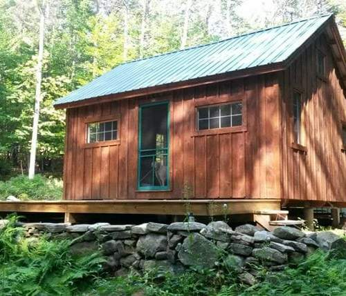 16x20 Vermont Cottage B post and beam cabin with pine board and batten siding