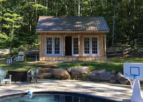 16x20 Vermont Cottage with patrician bronze roof color upgrade and three pairs of french doors.