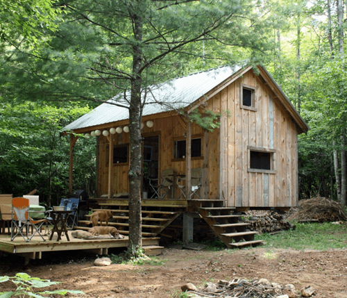 16x20 Vermont Cottage A with corrugated metal roof and pine board and batten siding