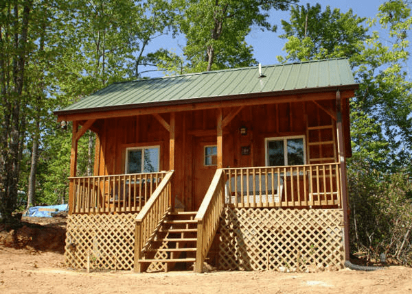 16x20 Vermont Cottage Option A with insulated windows, porch railing, lattice coverup under porch and client built stairwell.
